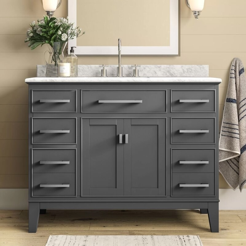 Maple gray vanity set with marble countertop and backsplash and silver handles