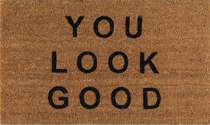 Brown doormat with black letters
