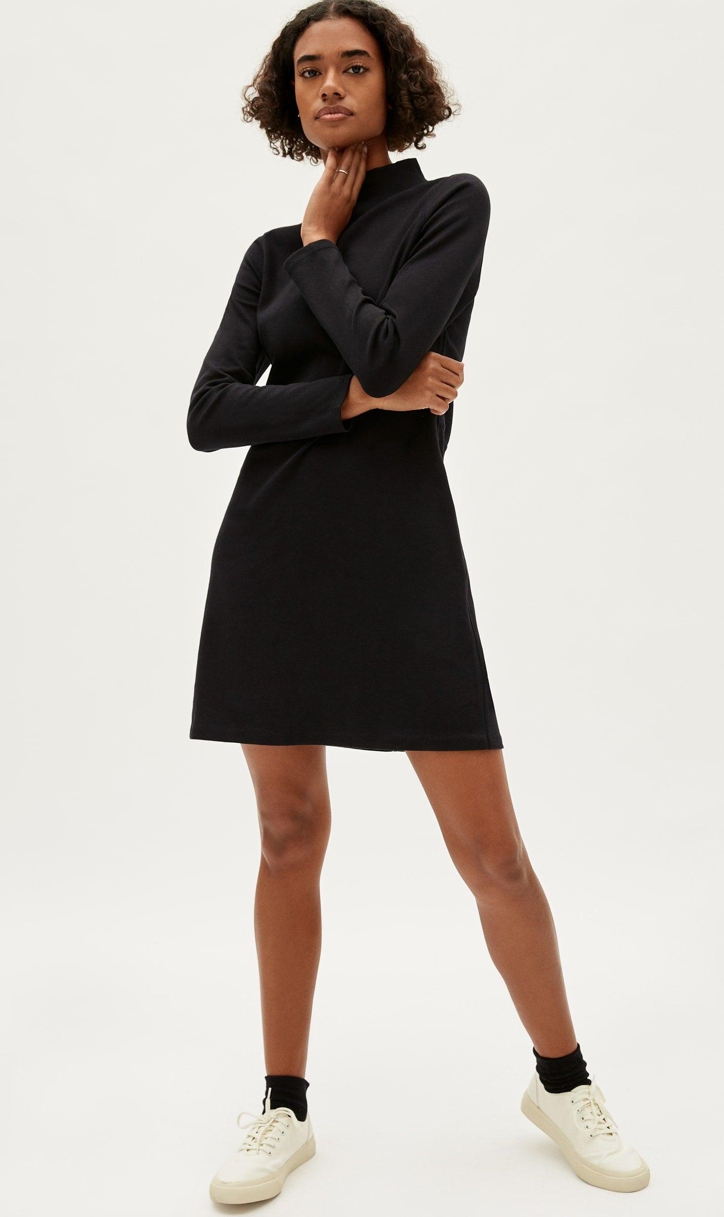 Model wearing black dress