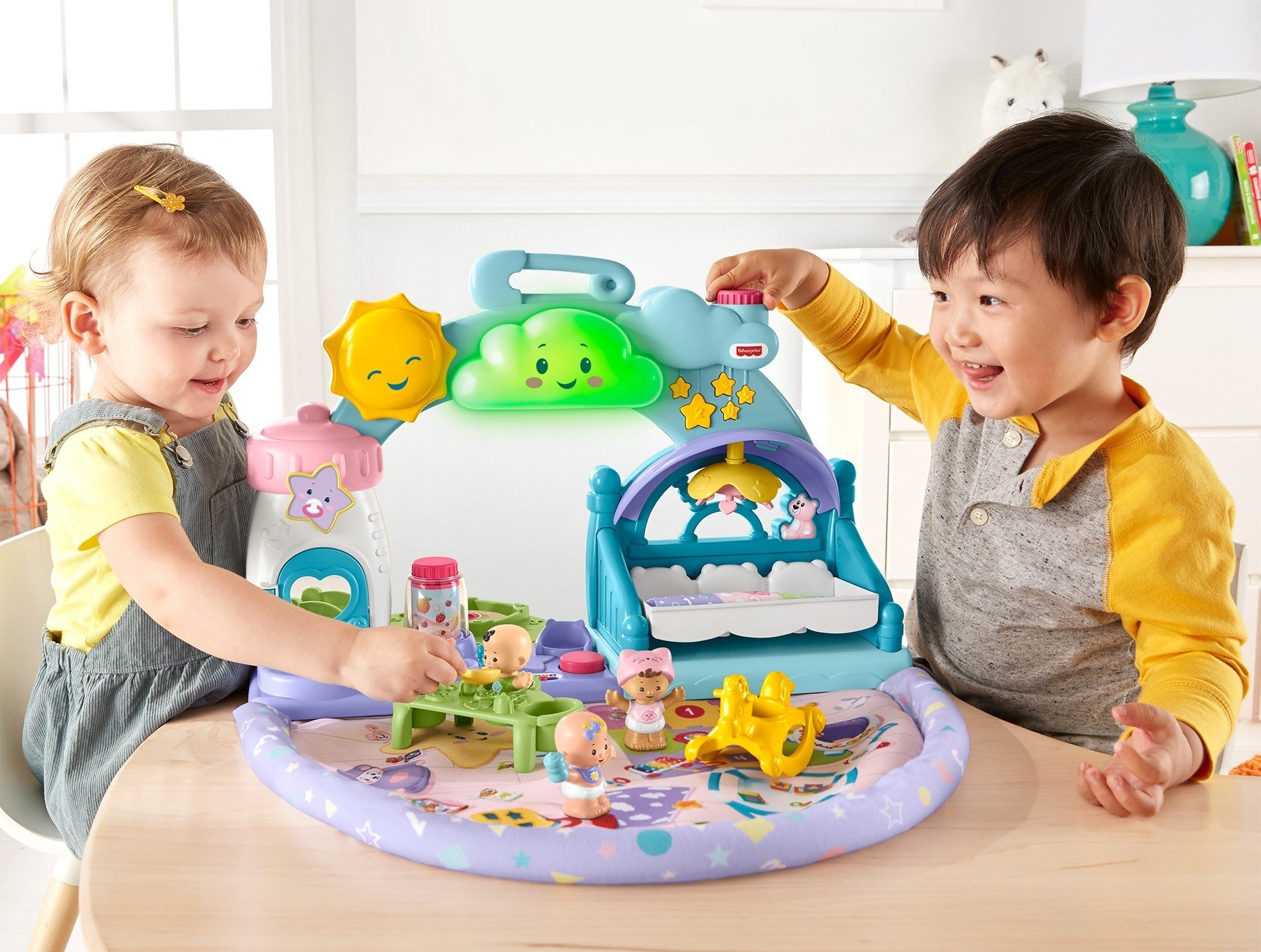 kids playing with a plastic playset with a soft bottom mat and interactive attachments