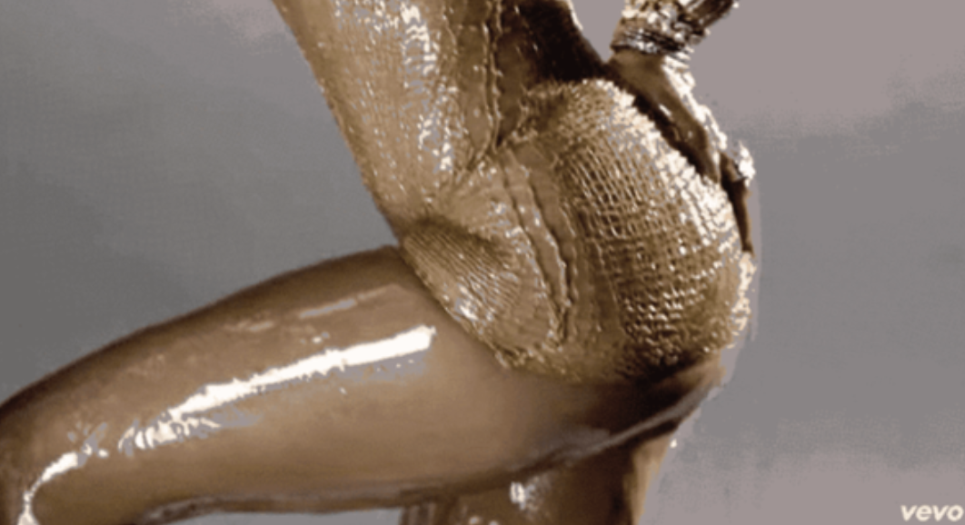 Jennifer Lopez all oiled up in a music video