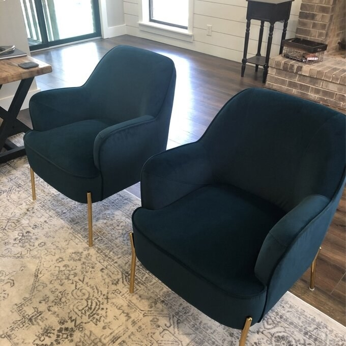 Reviewer's green velvet armchairs with gold chairs