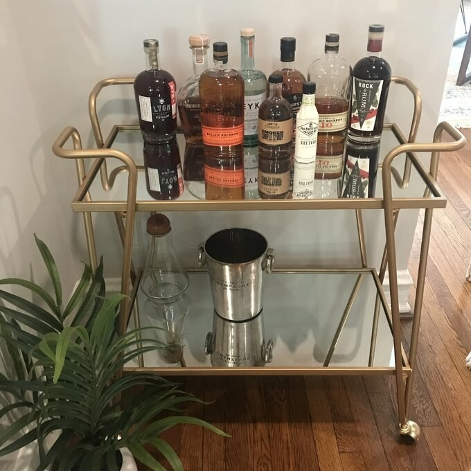 Reviewer's picture of the two-tier gold and mirrored bar cart