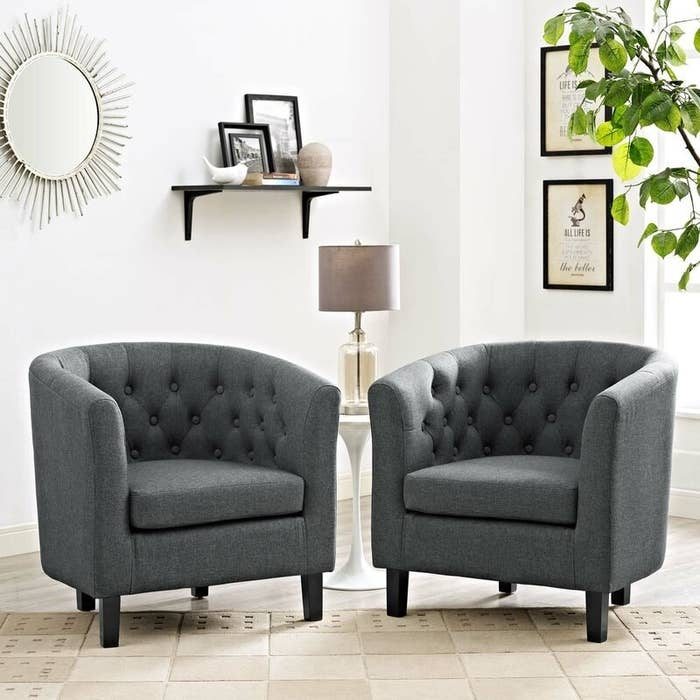 Two gray tufted arm chairs with round backs