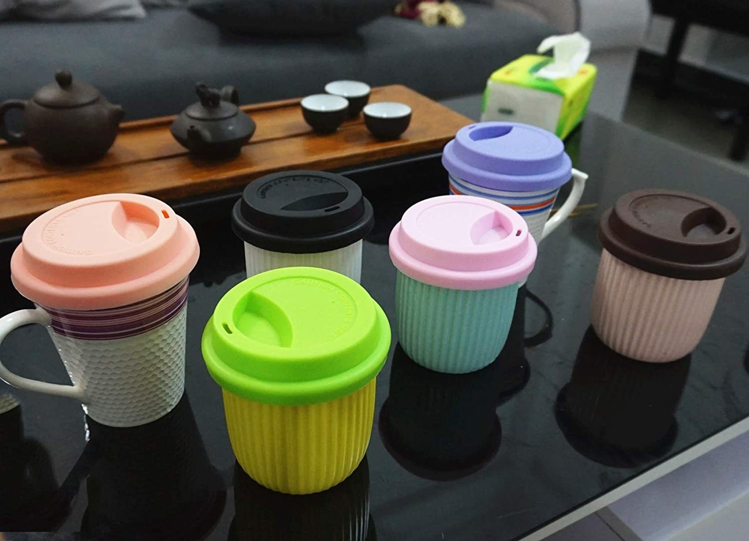 Silicone lids on several different mugs and cups