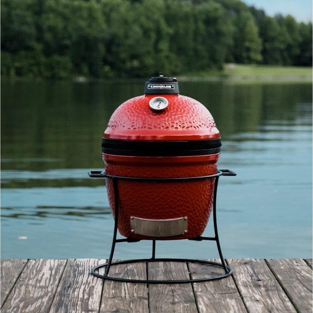 The red grill on a lake dock