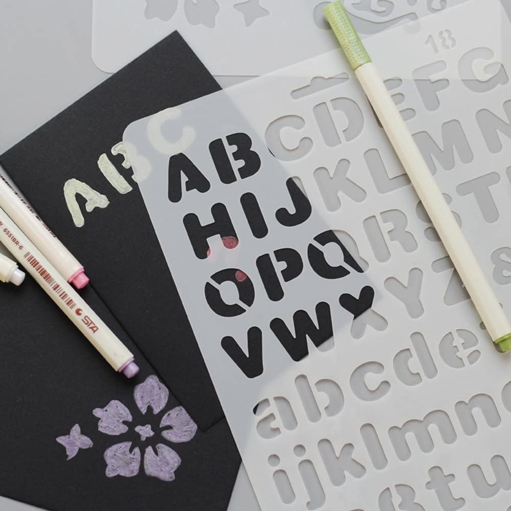 The stencils on top of a page surrounded by pens