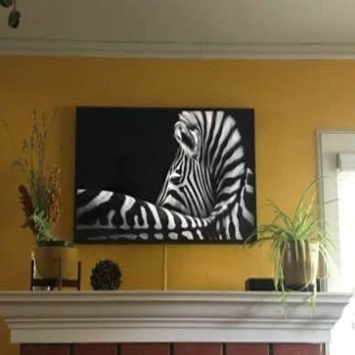 The TV in art mode on a reviewer's wall