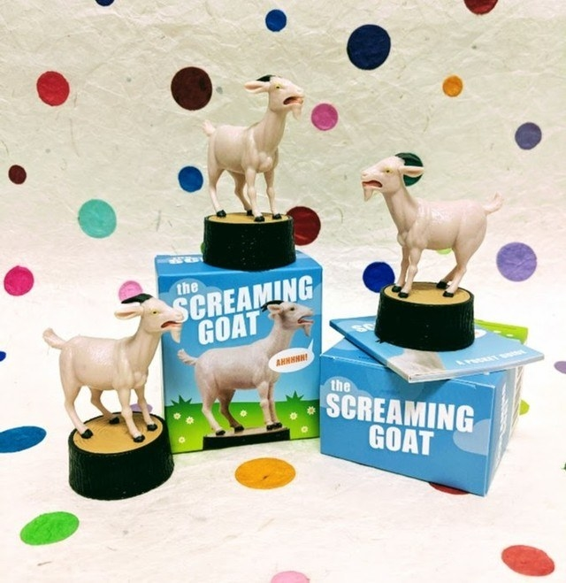 several screaming goats stacked on their boxes