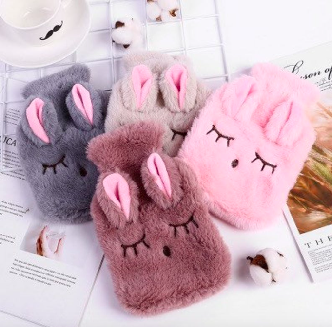 A set of four bunny-shaped hot water bottles