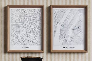 two framed Paris and New York prints