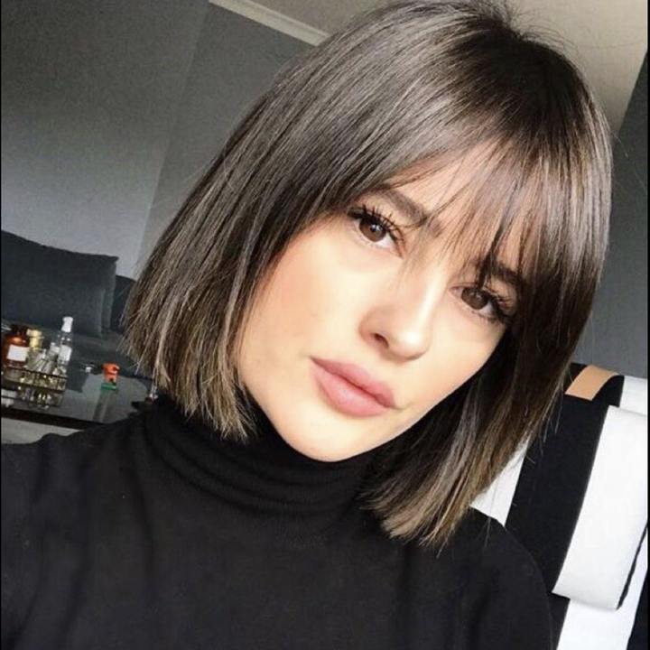 Reviewer with fresh bob hairstyle with bangs