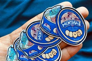 sticker of cookie tin used as sewing kit