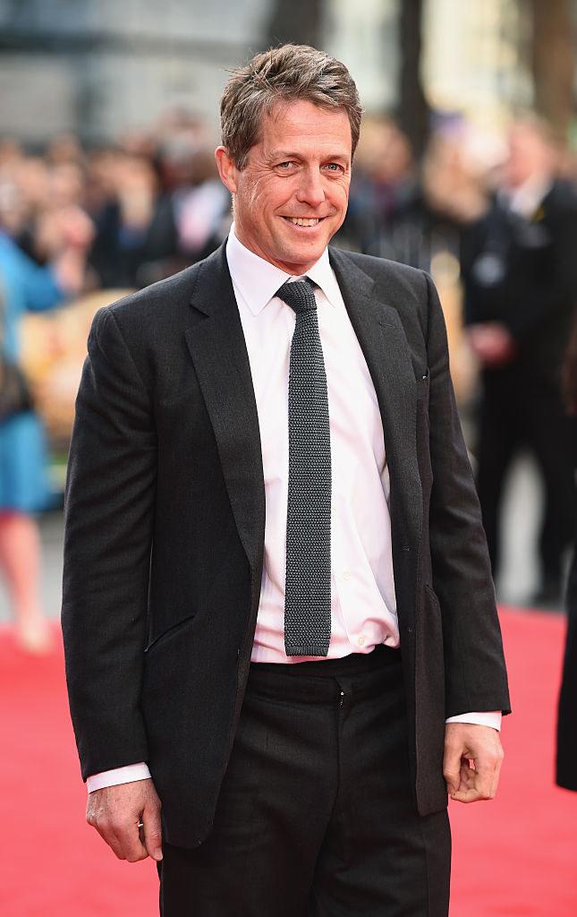 Hugh posing on a red carpet