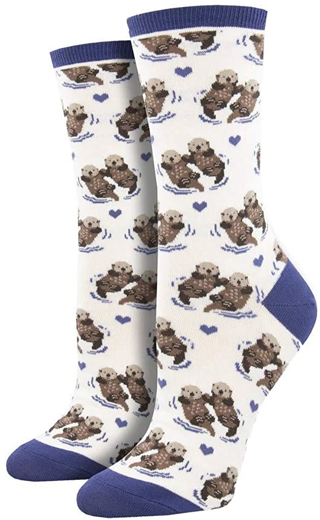 The white and blue socks printed with otters holding hands and little blue hearts