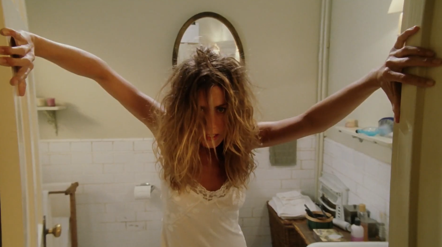 """Grace opening the door to the bathroom with her hair disheveled in """"Bruce Almighty"""""""