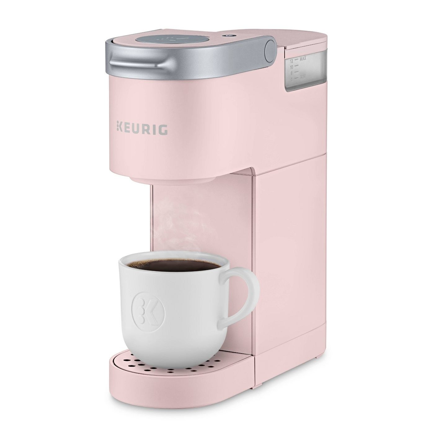 pink keurig k-mini single serve coffee maker with a white mug on it