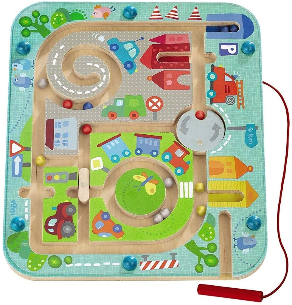 A toy that has kids move magnetic marbles through a maze with a stylus