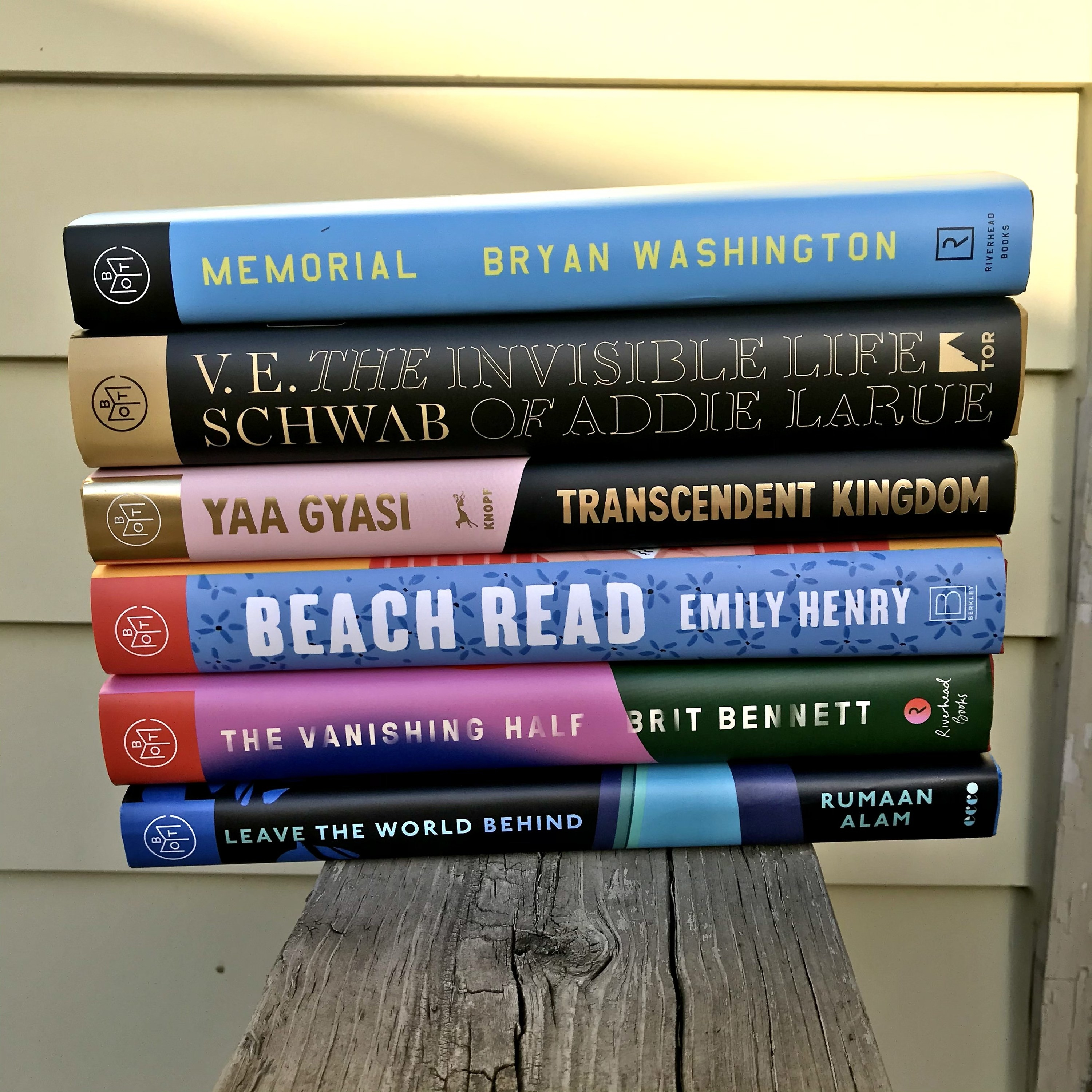 A stack of six different BOTM books the writer has received