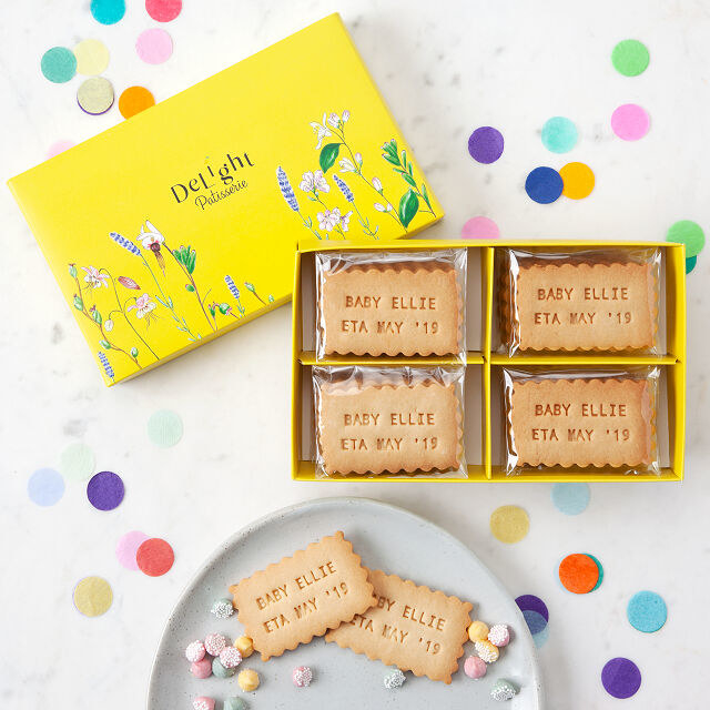 Scalloped edge rectangular shortbread cookies with pressed words on top