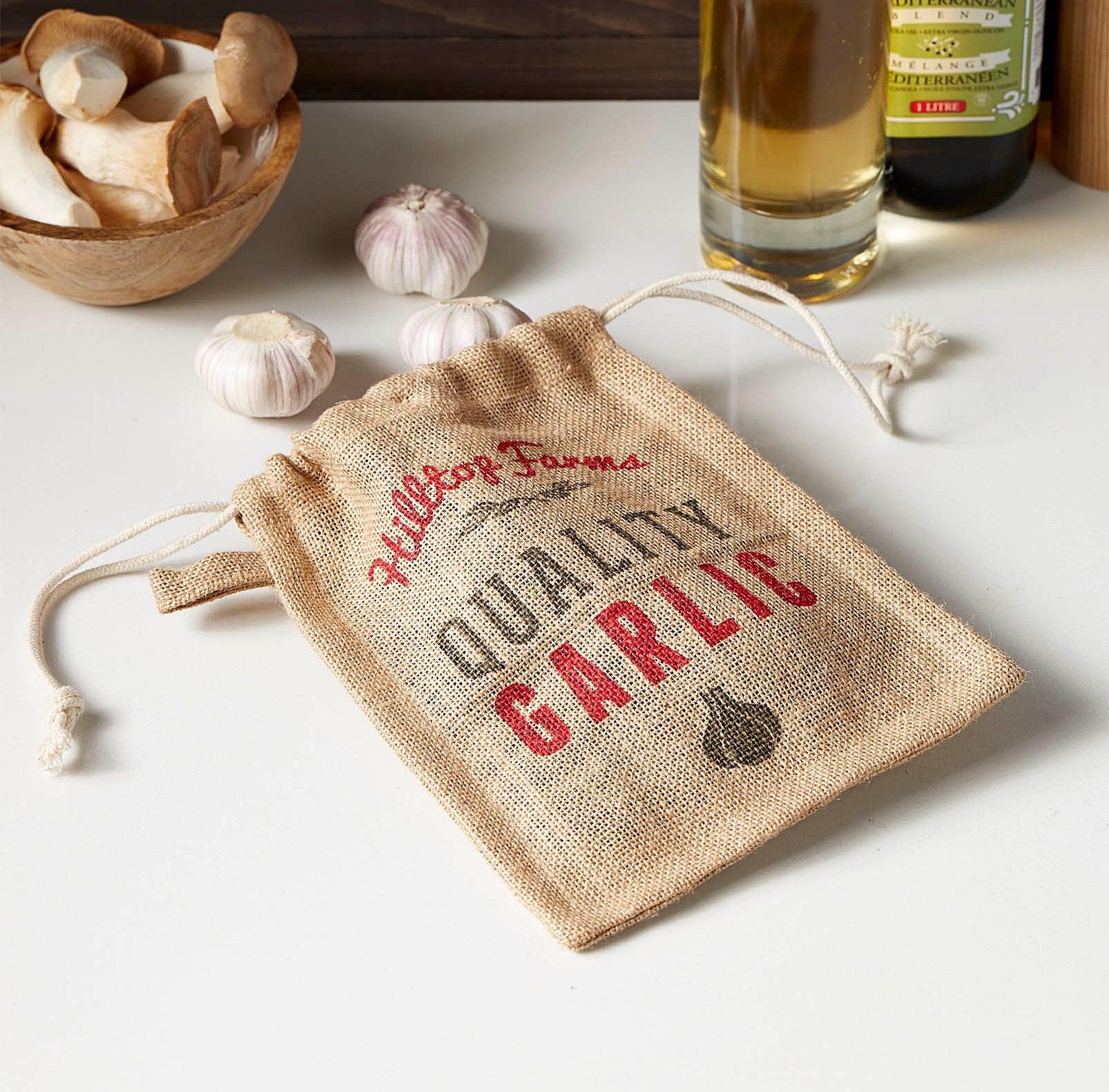 Several bulbs of garlic coming out of the garlic sack