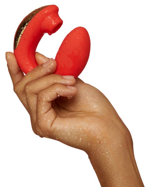 A model's wet hand holds the BuzzFeed AirVibe