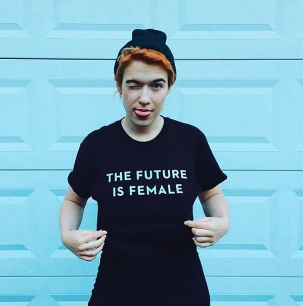 person wears the future is female tee