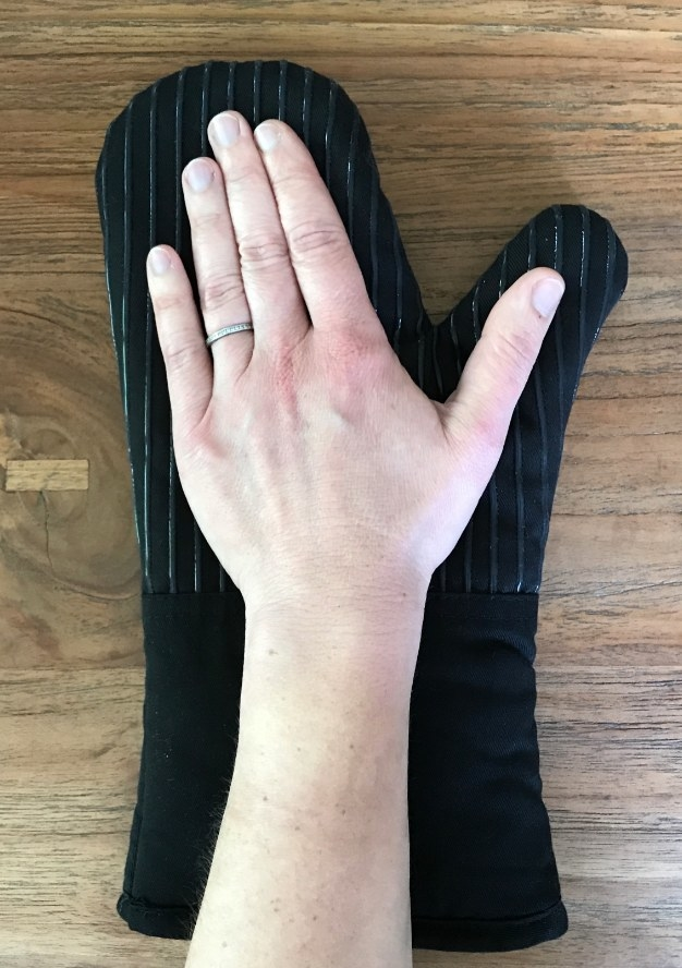 A hand on the mitt for size comparison