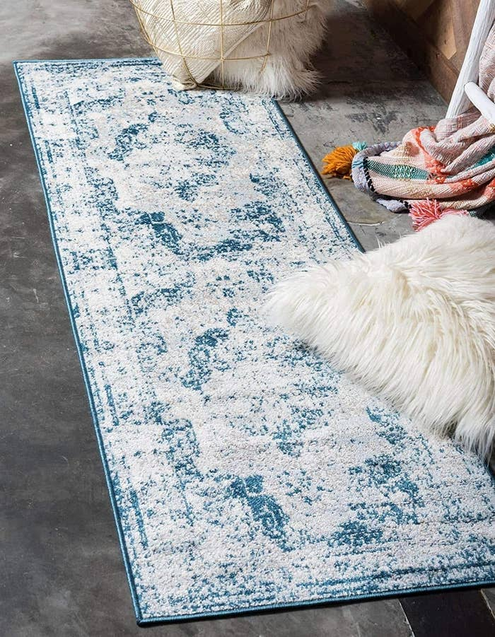 blue and gray vintage style runner on a bedroom floor