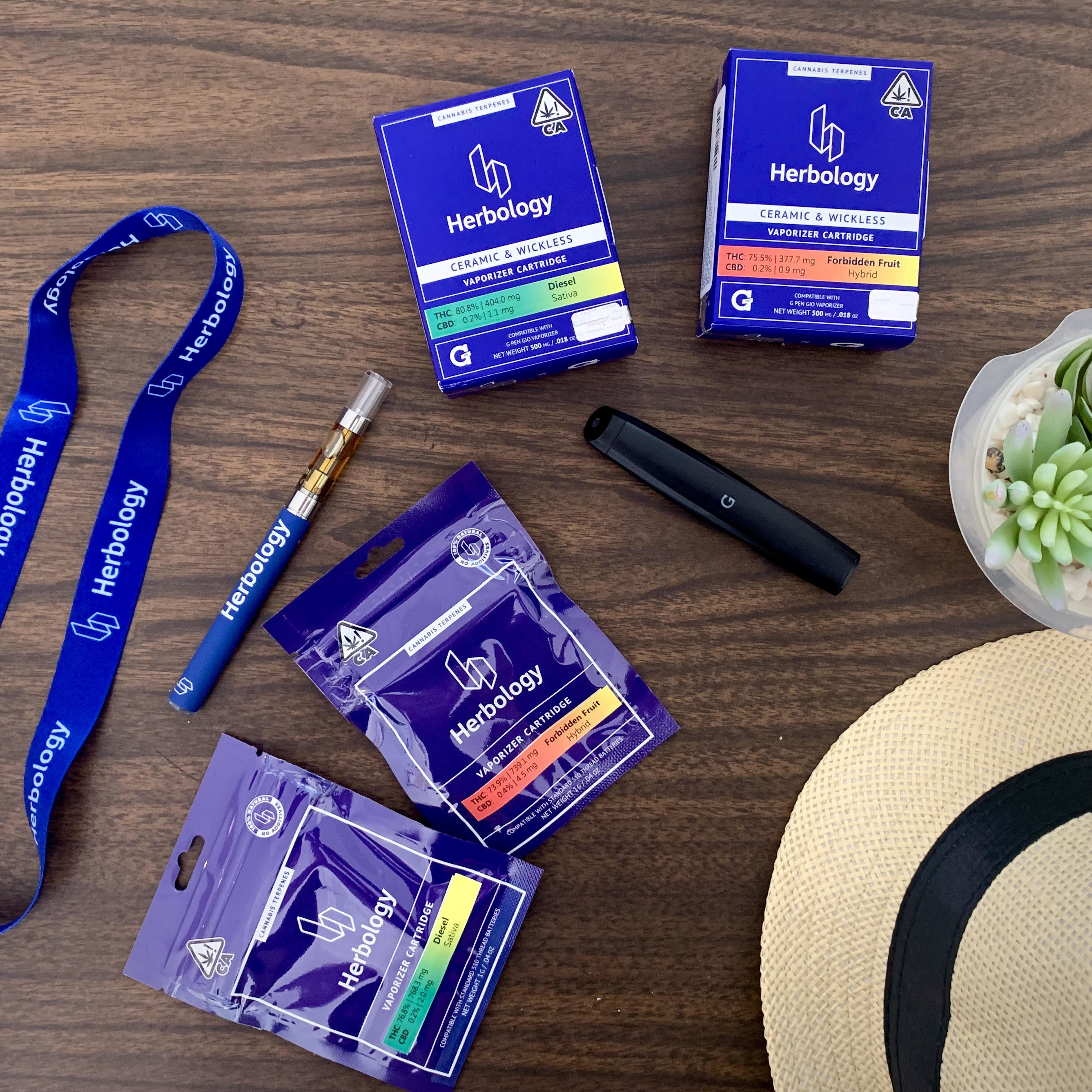 A smattering of Herbology products, including their vaporizers and cartridges