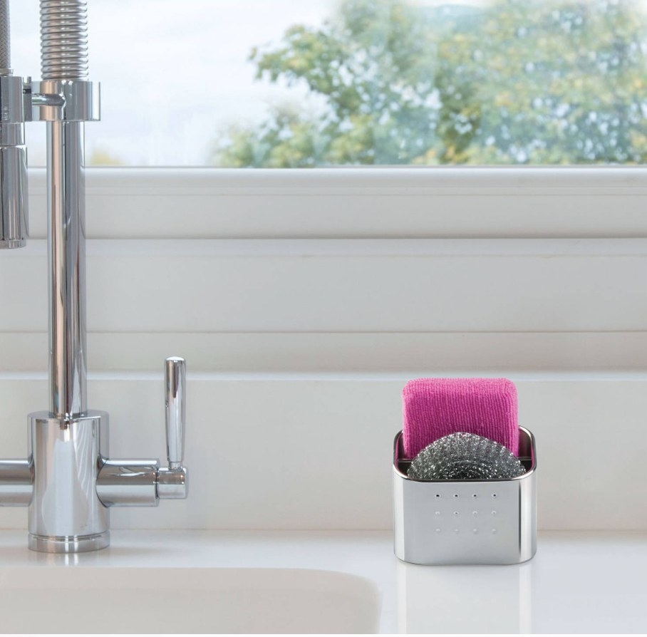 The sponge holder by a sink