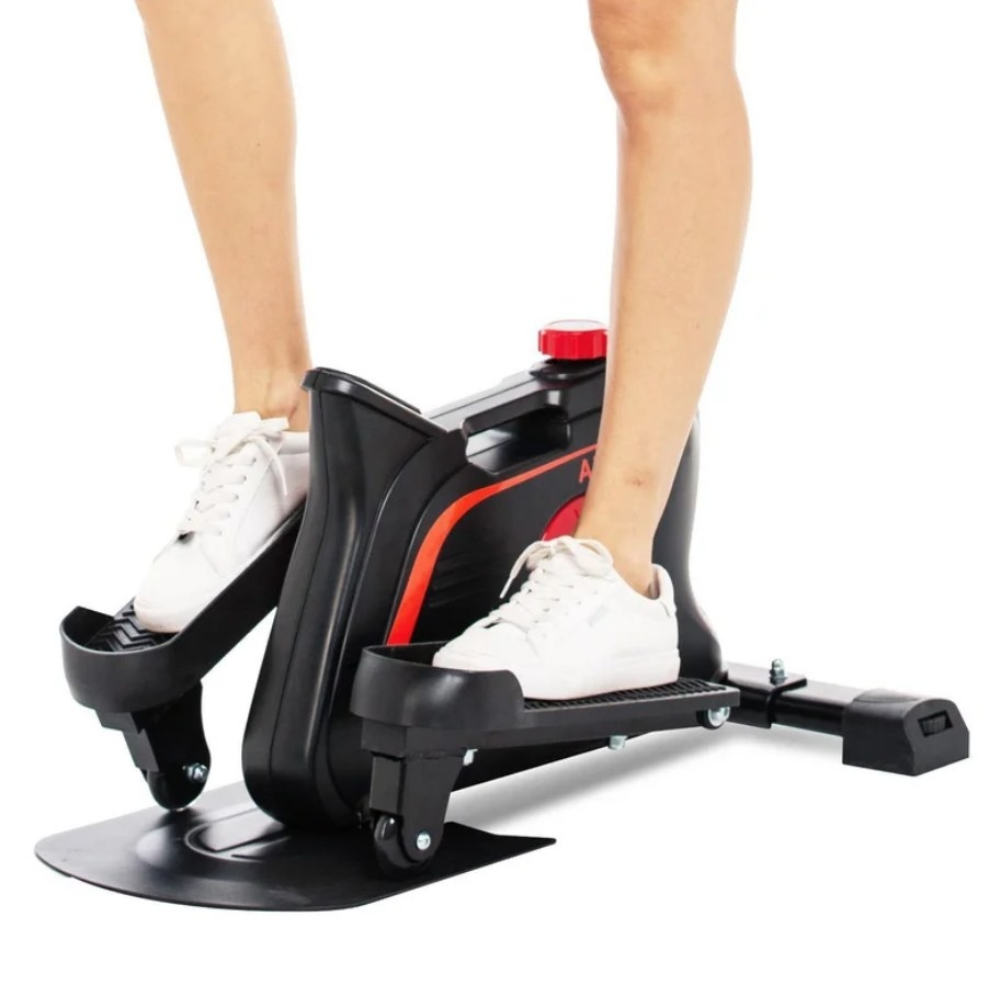 Legs with white sneakers using the foot bike