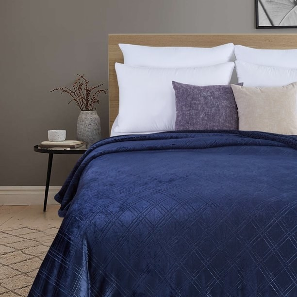 The blue blanket on a bed