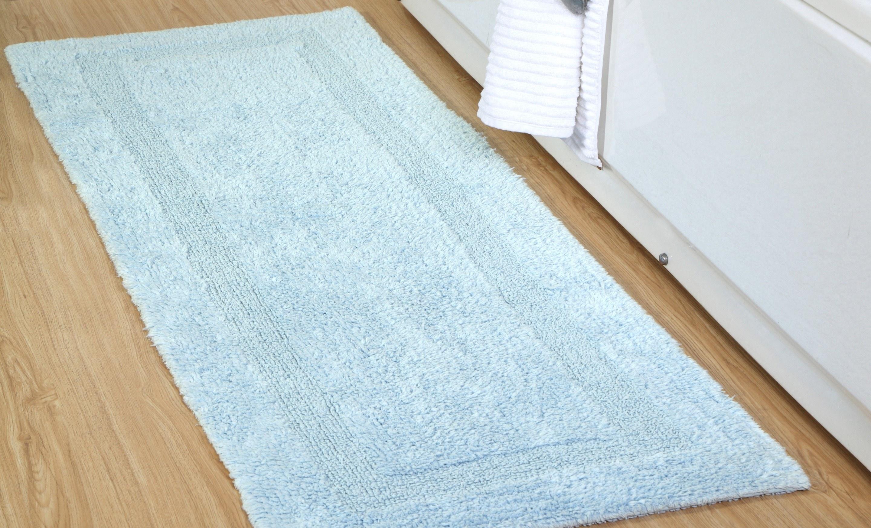 The blue mat on a wood floor