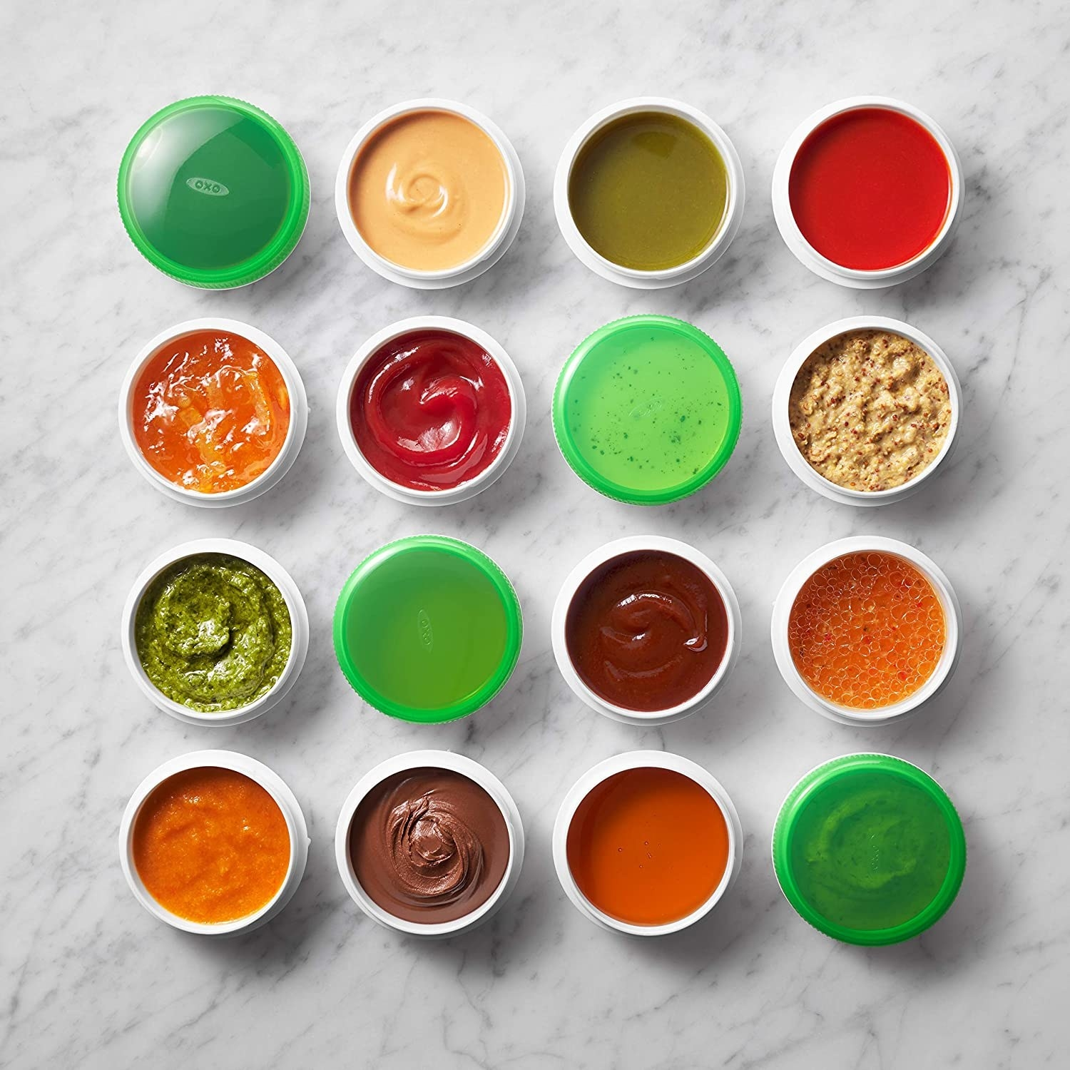 Several condiment cups filled with various dips and sauces