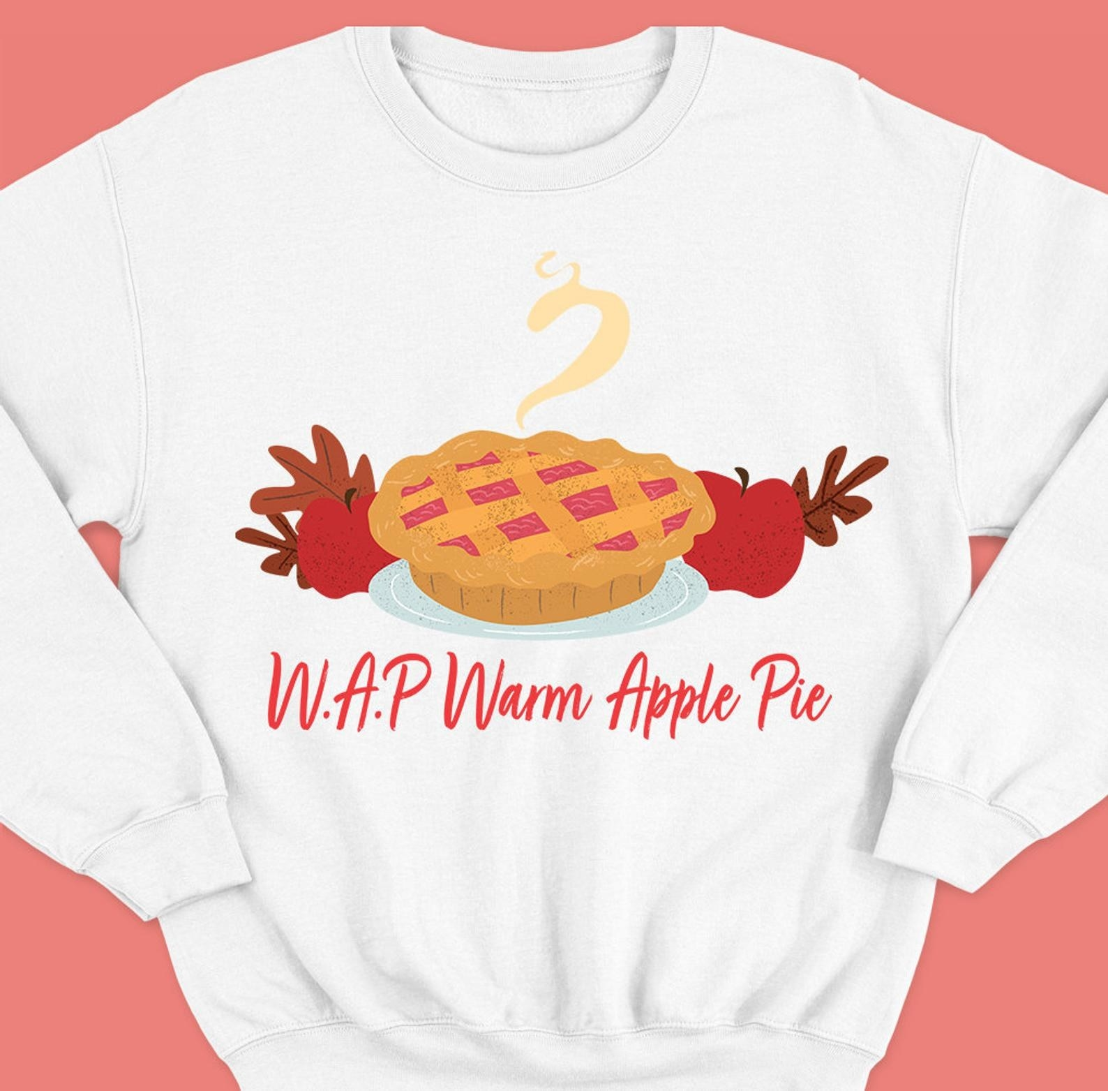"the sweater making a pun with Cardi B's song WAP, where WAP here stands for ""Warm Apple Pie"" with art of an apple pie"