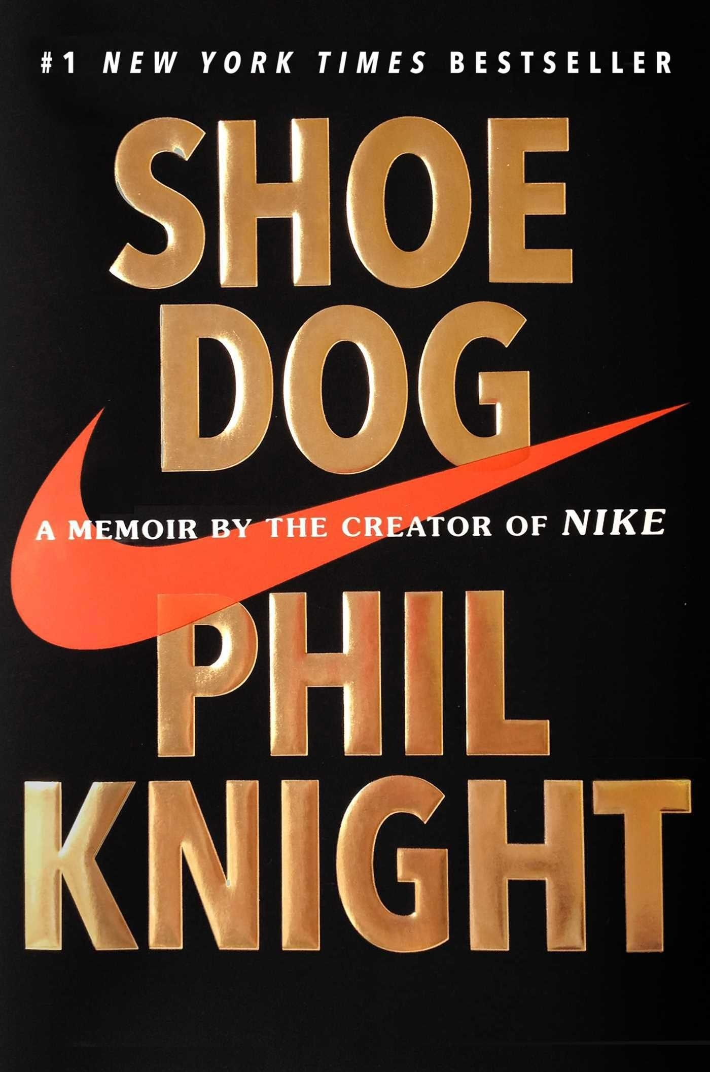 The cover of Shoe Dog with a big orange Nike swoosh logo across the middle