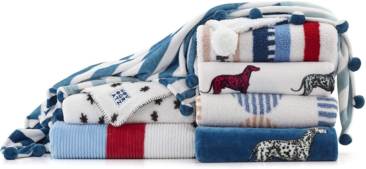 stack of various blankets