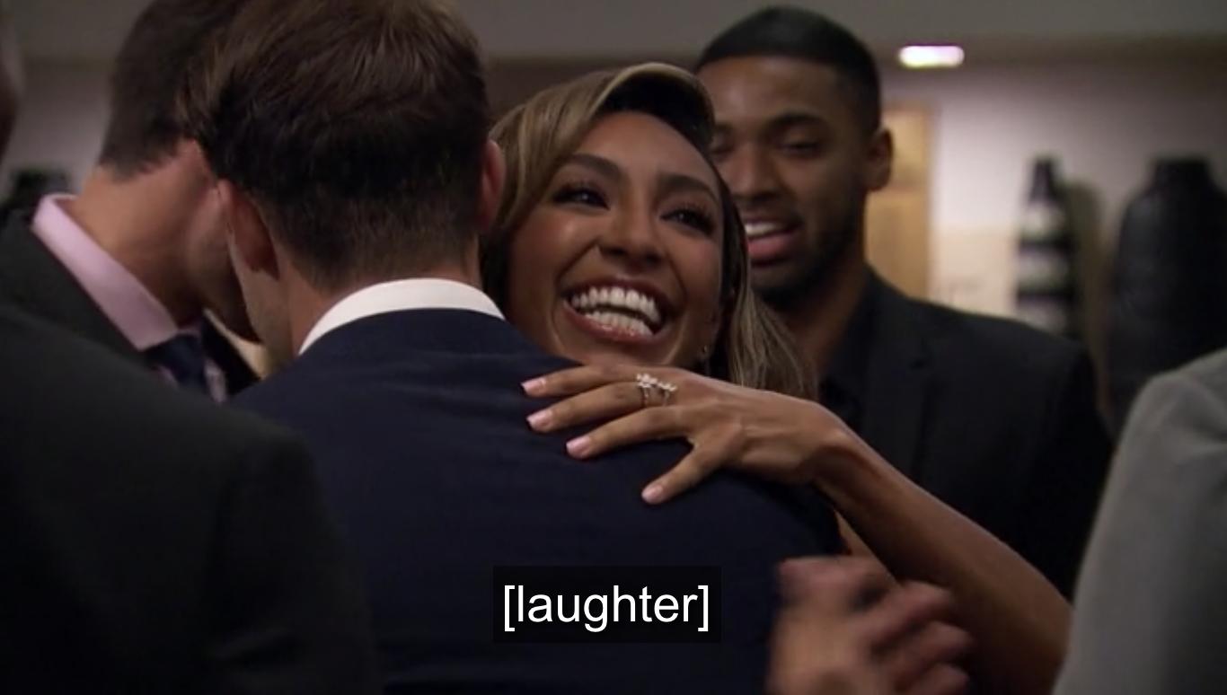 Tayshia hugging her suitors