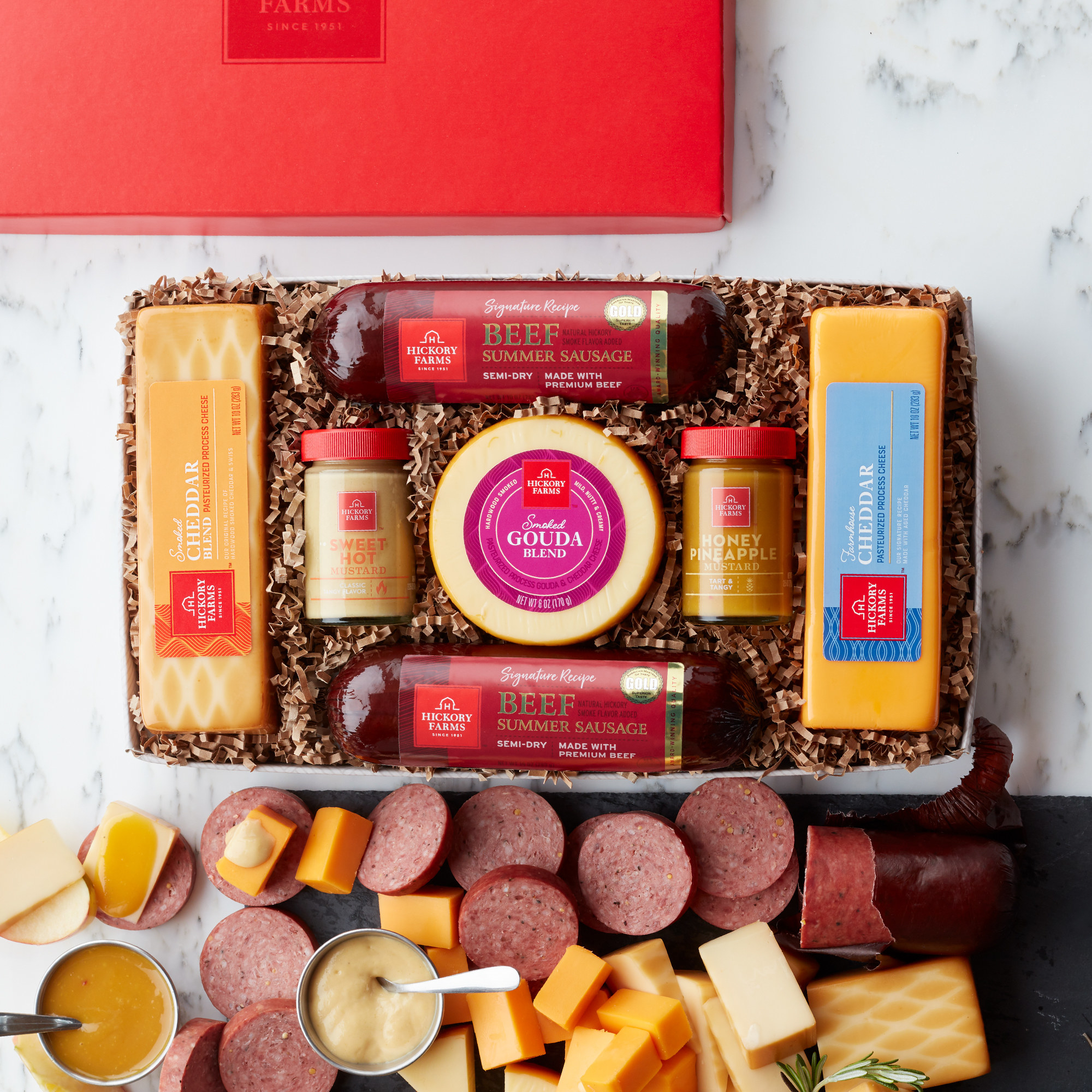 Box with packed sausage, cheese, and mustards