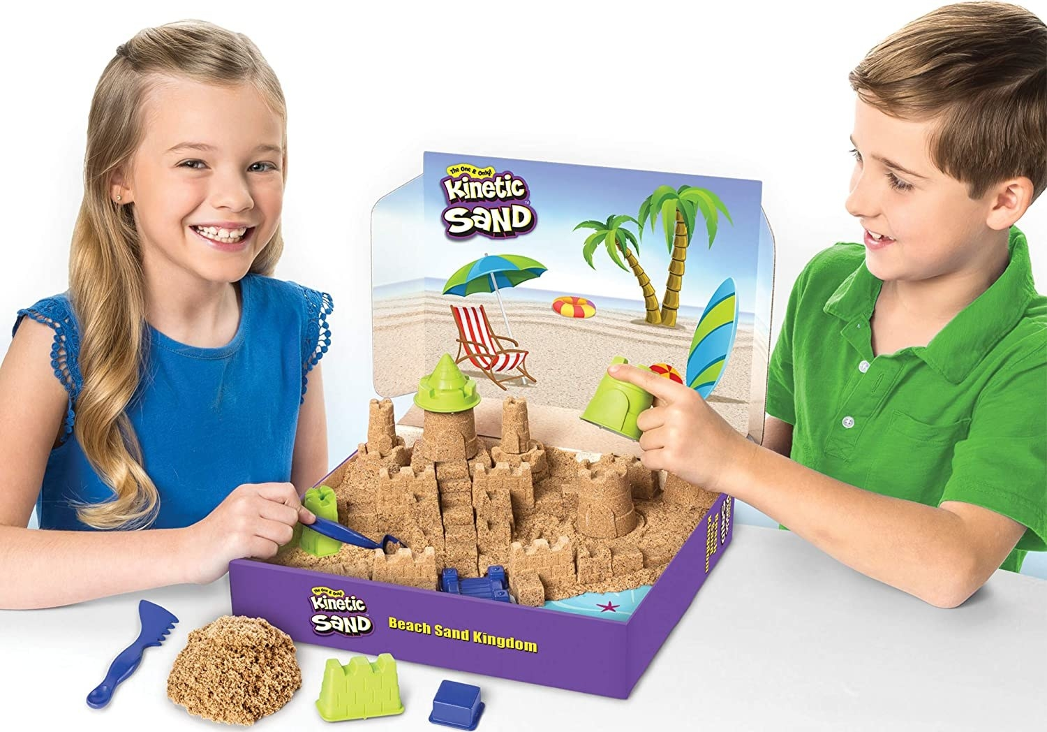Two kids make a sandcastle with Kinetic Sand