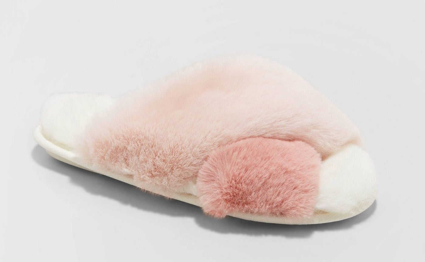 pink and white slide slipper in a fluffy fabric
