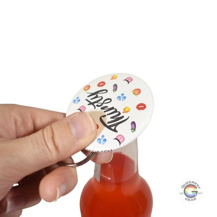 a hand using the bottle opener