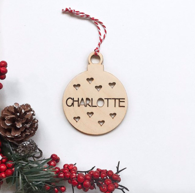 A wooden ornament with the name Charlotte inscribed on it