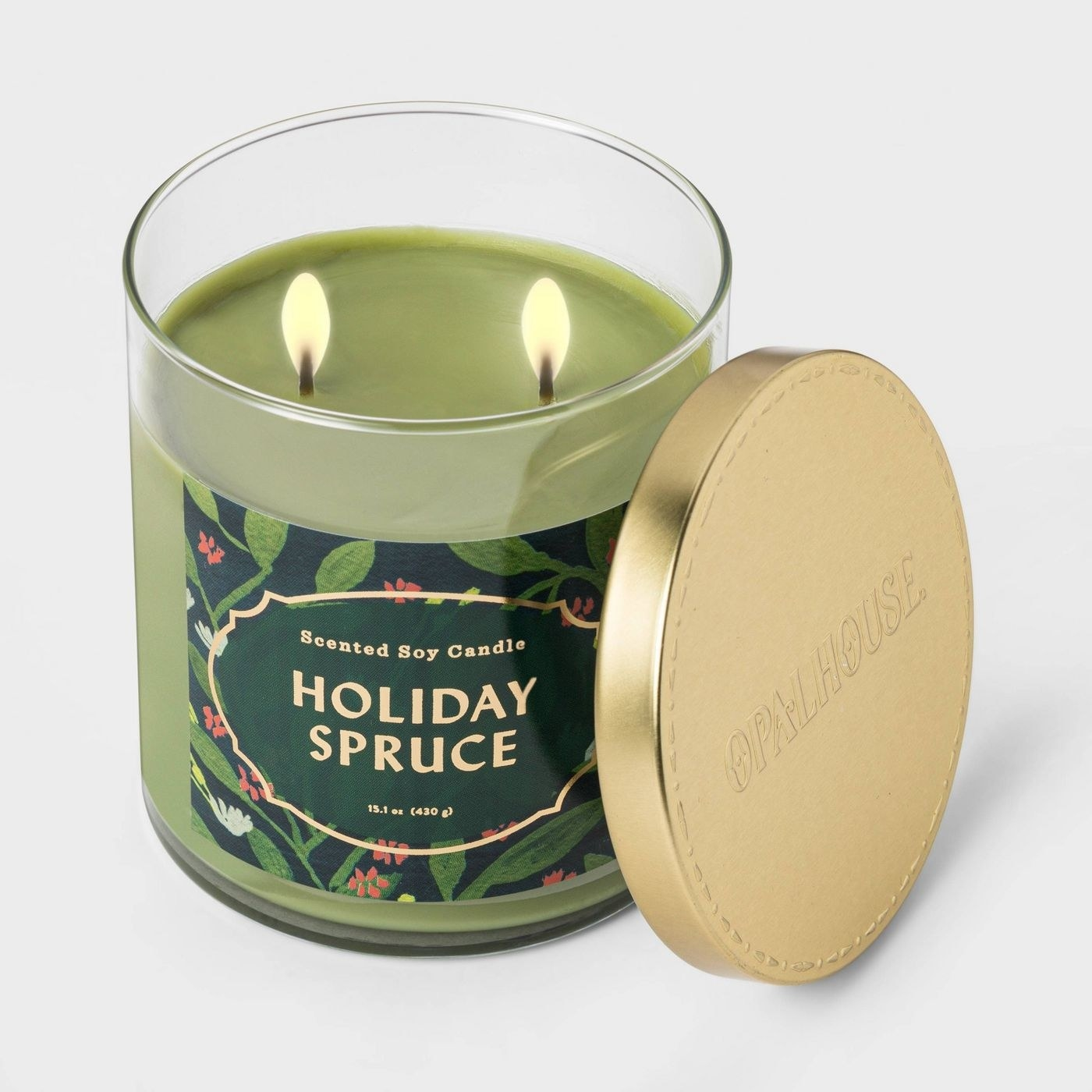 a lit holiday spruce candle from opalhouse