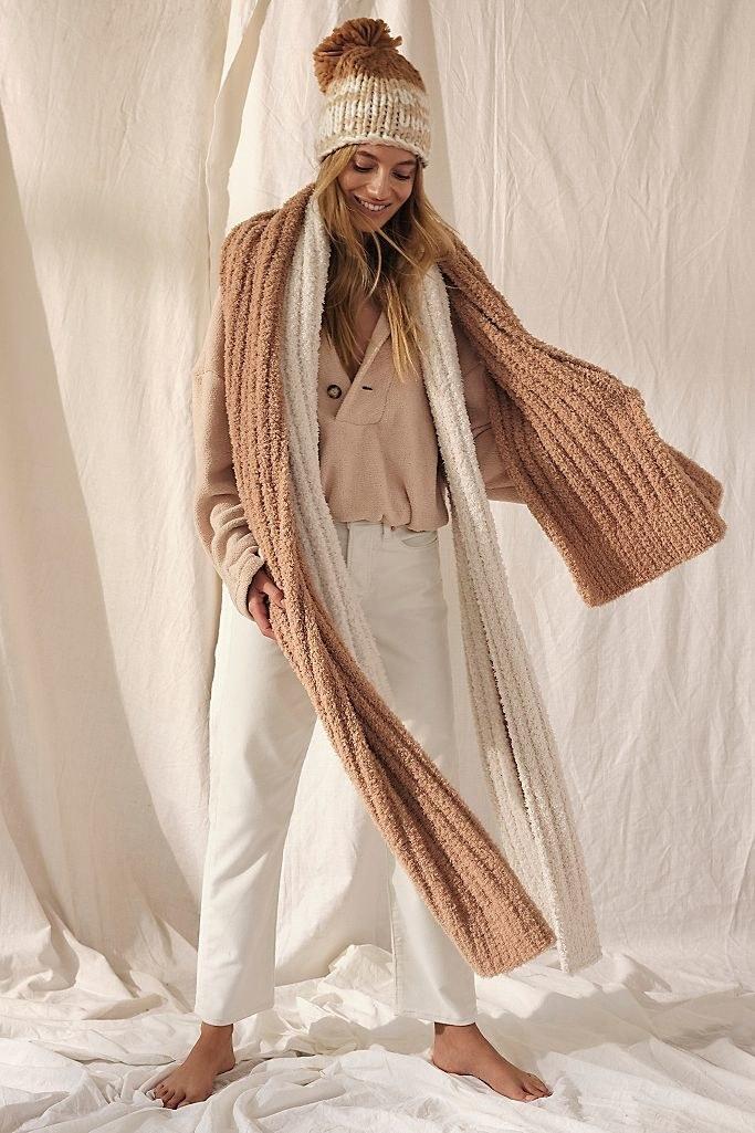 Model in a beige oversized plush scarf