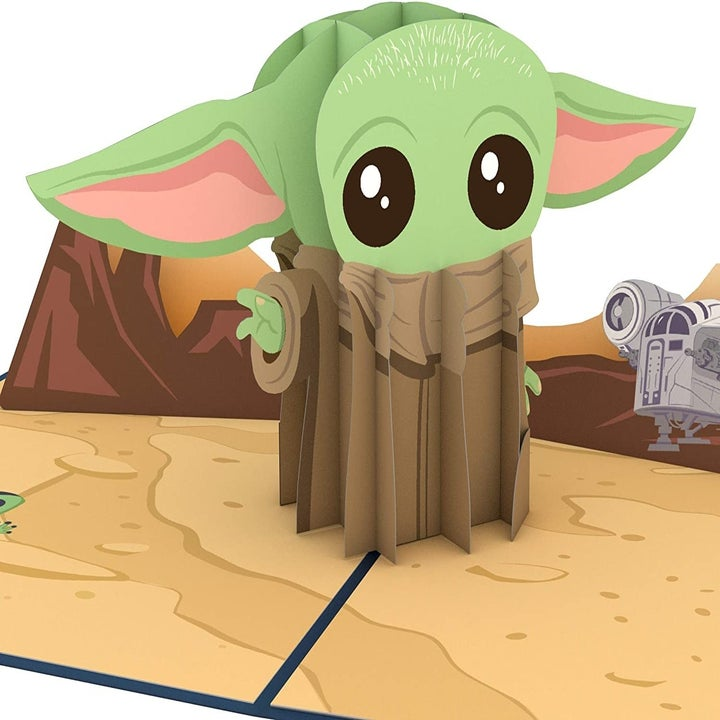 Card open with Baby Yoda popped up in the middle, with a desert background