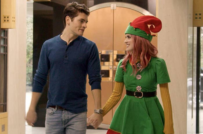 Kat Decker, dressed as an elf, and Dominic Wintergarden holding hands