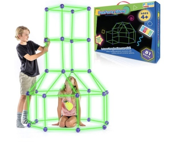 two children building a fort with glowing sticks
