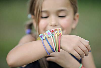 a child wearing a bunch of the colorful hair ties
